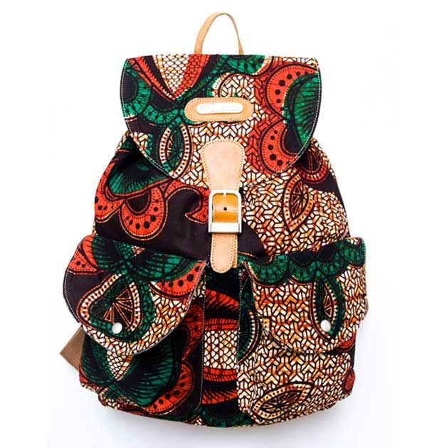 """Very edgy, this green ankara print fabric canvas shell with rich leather accents is a twist to your standard canvas backpack. A mix of vibrant African print meets """"The West"""" makes this bag your ultimate statement backpack bag. Flap and drawstring closure keeps your belongings secure Interior pocket is great for storing your valuables such as mobile phone. Front pouch pockets are perfect for a wallet and sunglasses"""
