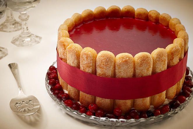 This charlotte russe recipe has strawberry Bavarian cream, liqueur-soaked ladyfingers, and a cranberry glaze that's perfect for Christmas entertaining.