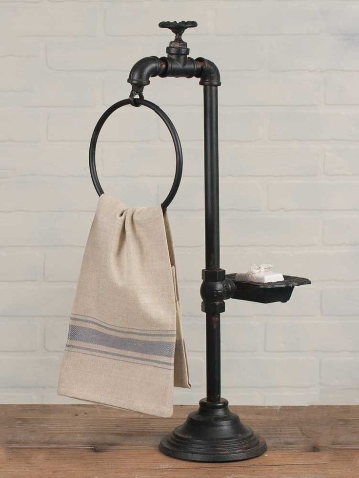 "Spigot Soap & Towel Holder Hang your towels on this useful rack in the bathroom or the kitchen.  Accessories are not included.  11"" wide x 5 ¾"" deep x 23 ½"" tall."