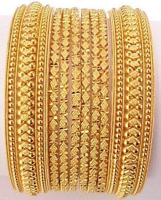 Beautiful and bold gold bangles. - know about indian culture and visit india with us get best and cheap tour deal