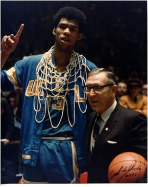 1969 - Lew Alcindor (Kareem Abdul-Jabbar) and UCLA basketball coach John Wooden - after winning the NCAA National Basketball Championship - Lew has an unprecedented rookie contract for $1 million waiting for him with the Milwaukee Bucks.