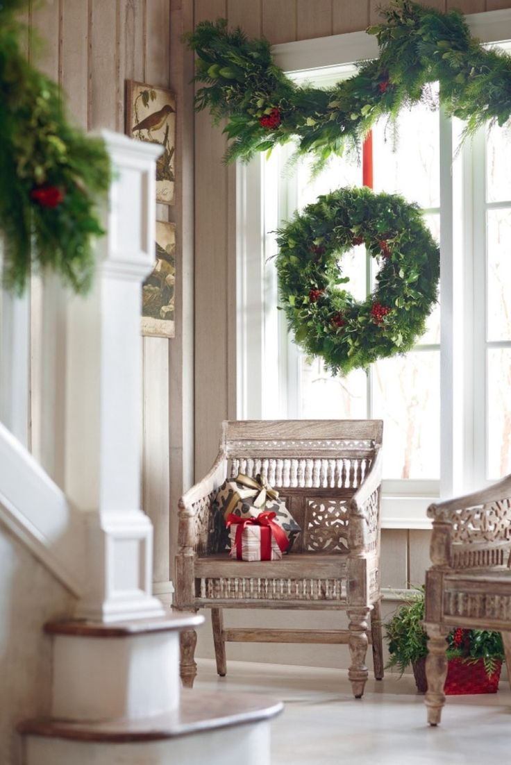 Christmas decoration ideas for windows - Decoration Rich Garland Over Wreath For Perfect Christmas Window Decoration And Antique Armchairs With Gifts