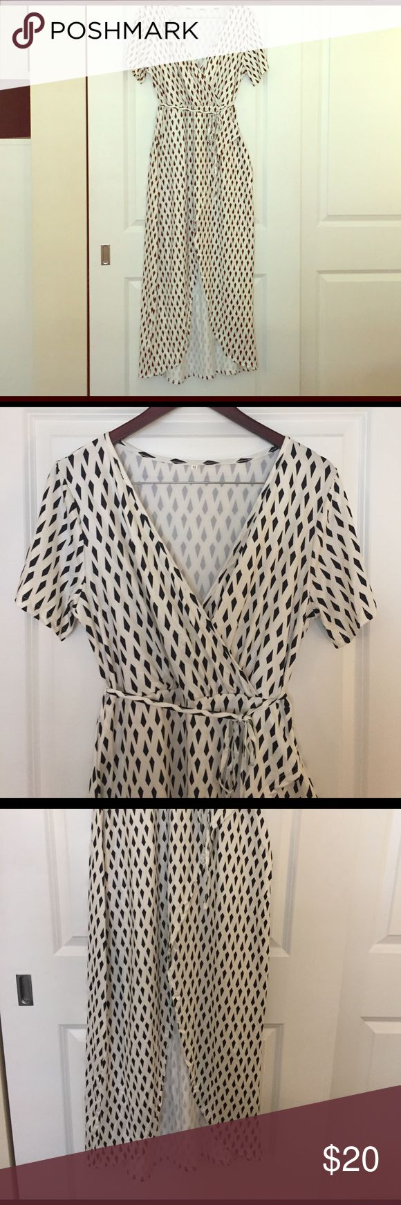 Black and white maxi dress Smooth and sleek black and white patterned maxi dress. New without tags. Spandex with large slit in front. Dresses Maxi