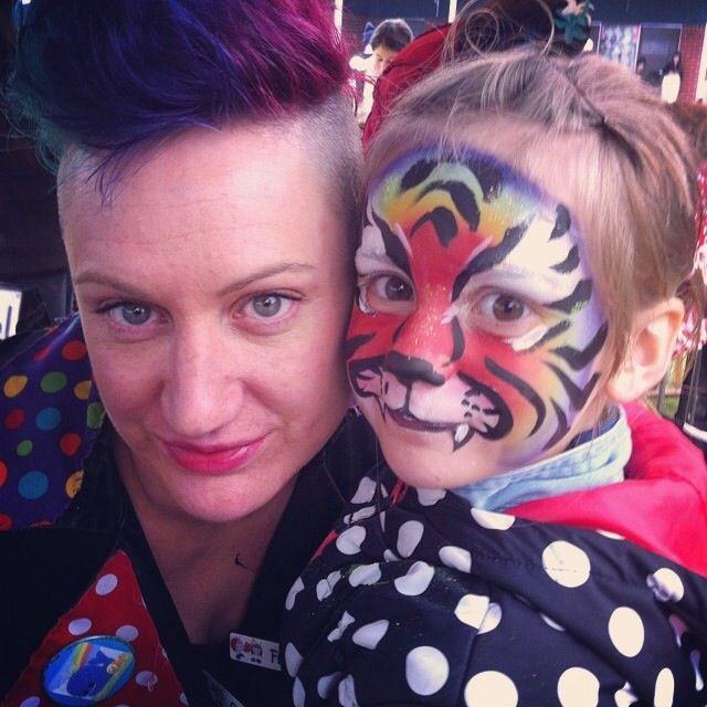 A rainbow tiger face paint #rainbow #mohawk
