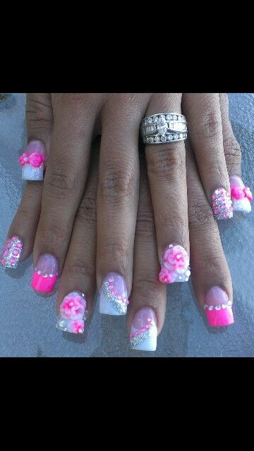 Pink and silver acrylic nails with 3D art