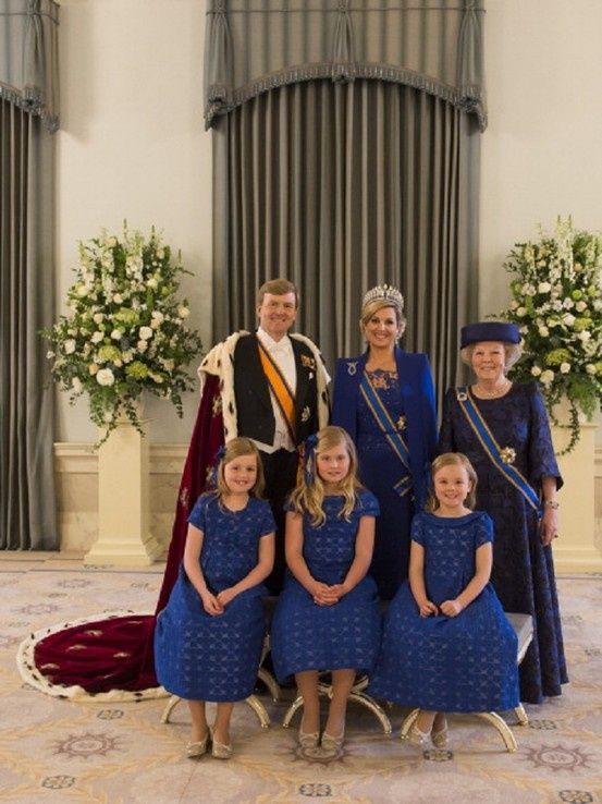 King Willem Alexander and Queen Maxima of the Netherlands with Princess Beatrix of The Netherlands and Princess Alexia, Catharina Amalia, and Princess Ariane following the Inauguration of Willem as King of Netherlands Ceremony, posing at the Royal Palace 4/30/13.