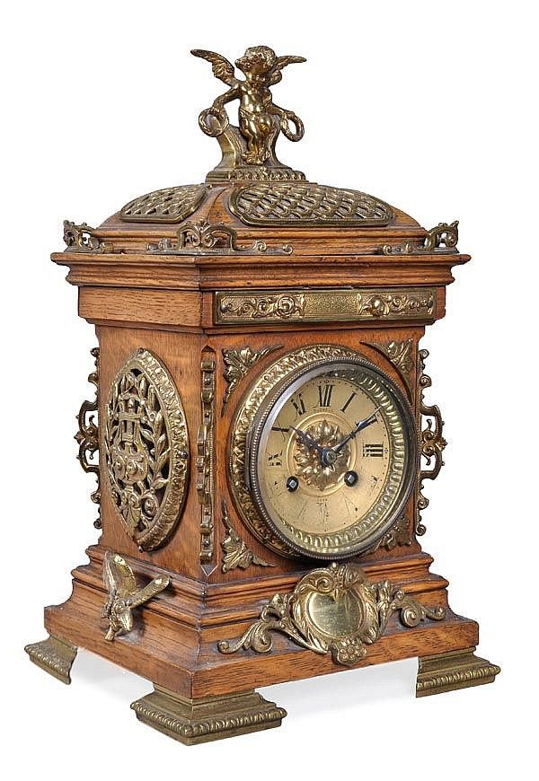 "Clock Hourglass Time: French gilt brass mounted oak mantel #clock, by Bushell, York, circa 1900; 8-day gong striking movement. 14"" h."