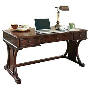 The handsomely designed Devrik desk creates a spacious work area with just the right amount of storage. Two drawers on each side and a pull-out keyboard tray behind the center drawer help to organize the business at hand. A curving trestle base frames the desk on a graceful note. Assembled in the United States with global components. Signature Design by Ashley is a registered trademark of Ashley Furniture Industries, Inc.