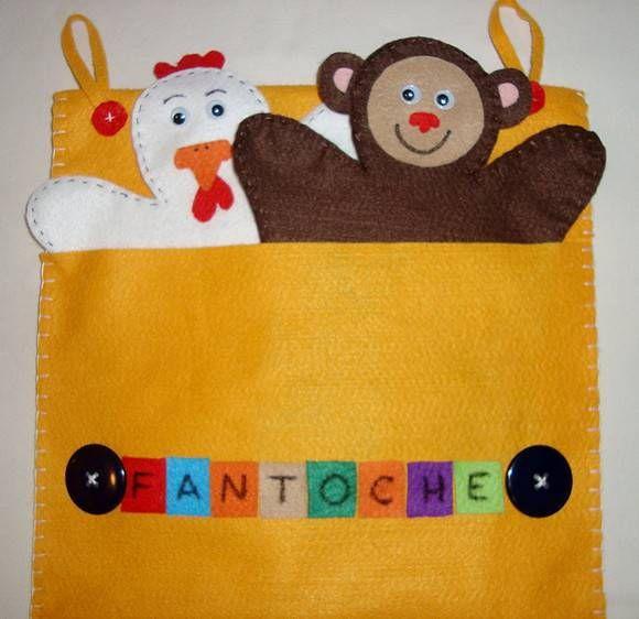 Esta bolsa em feltro (25x20cm) contém 5 fantoches com formas de animais. Pode ser pendurada quando está aberta. Ideal para crianças em idade pré-escolar. Permite que a criança brinque, desenvolva sua criatividade e fantasie histórias.  Podemos confecionar os fantoches fazendo referência a diferen...