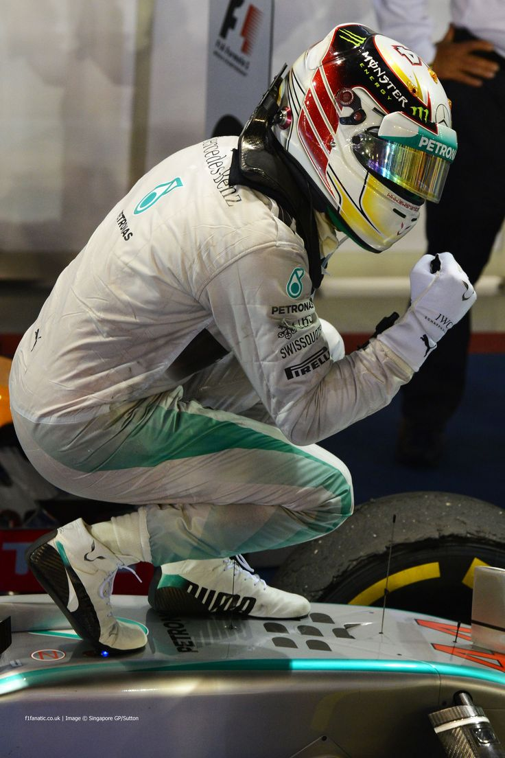 Lewis Hamilton pumps his fist aboard his Mercedes W05 following a dominating and clean weekend at the 2014 Singapore Grand Prix which saw him grab a 3-point WDC lead following a win.