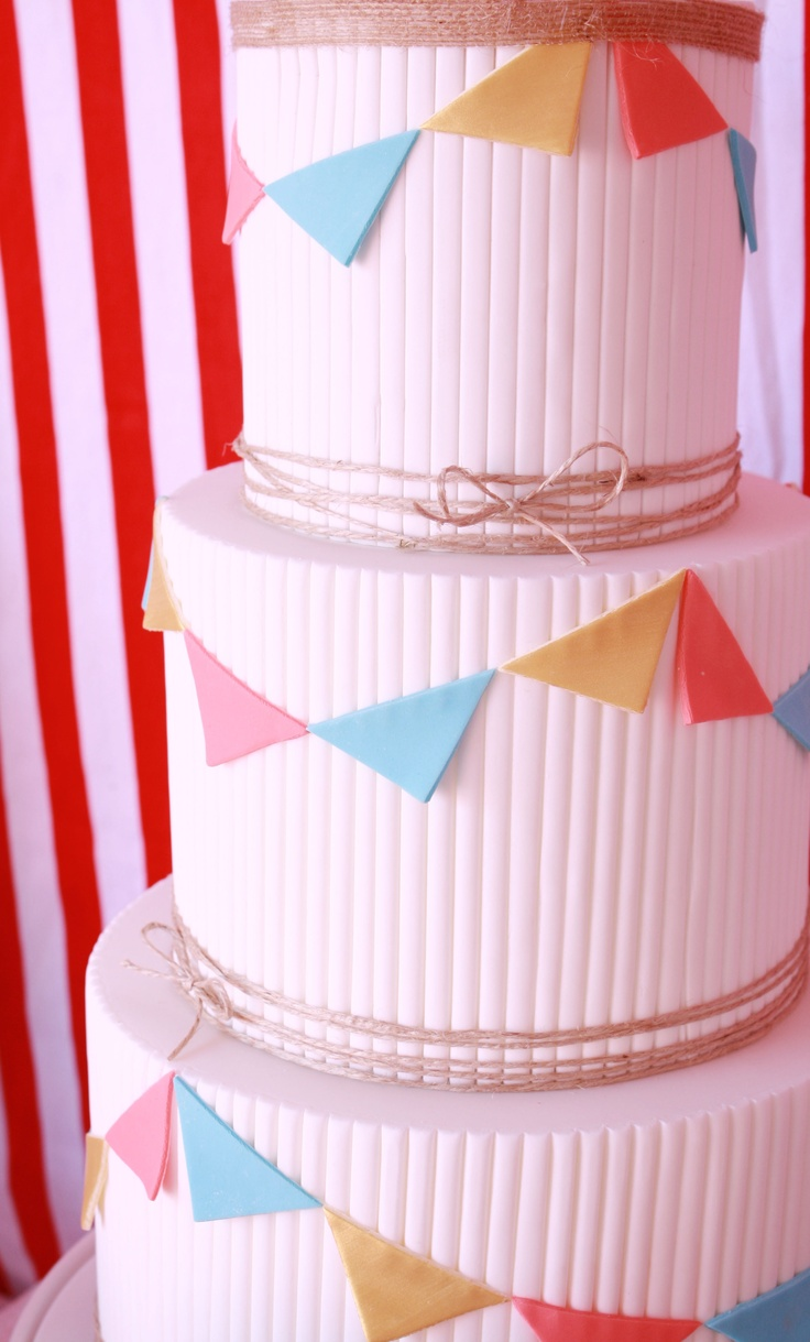 Circus carnival cake by Couture Cupcakes and Cookies  for a table styled by Mon Tresor