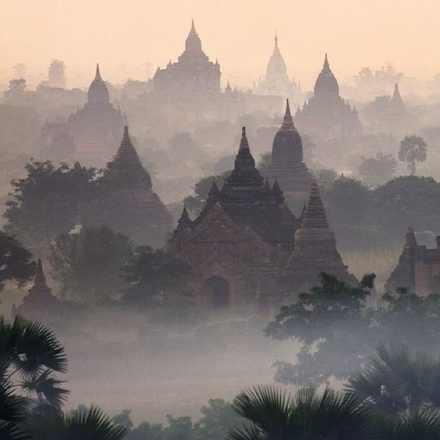 As the sun rises over the peaks at Bagan.. the ancient world sleeps #Cambodia