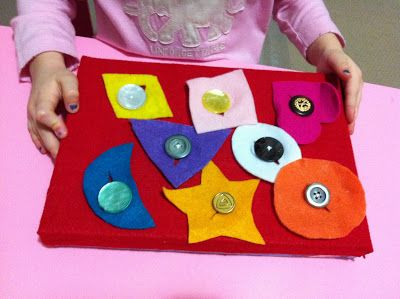 sew buttons on felt, cover box top, cut shapes with button slit from felt, store in box