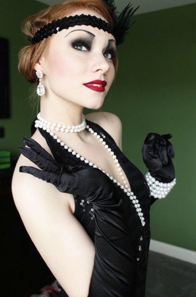 Lizbeth goes to the Winter Ball dressed as a flapper, all in black.