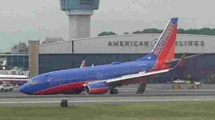 southwest flight 345 A southwest flight 345 from nashville to laguardia landed without use of its front wheel, causing traffic to stop at new york's laguardia airport.