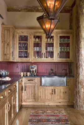 Western Ranch Kitchen    Rinfret, Ltd. - Great cabinets & pulls! Love the glass & twig fronts!