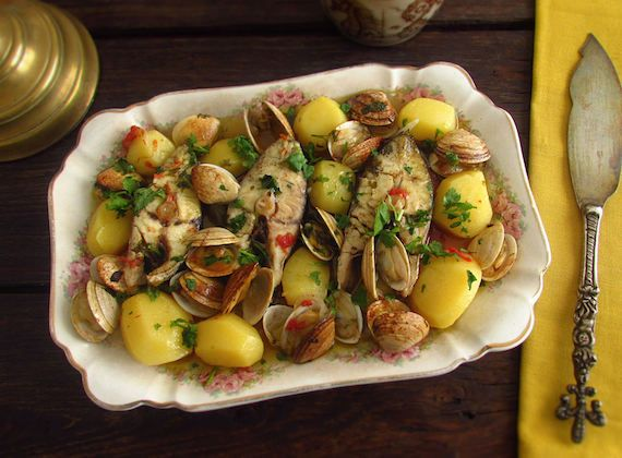 Wreckfish in the oven with clams | Food From Portugal. Wreckfish in the oven with potatoes, onion, garlic, tomato, bay leaf, leek and red pepper, drizzled with olive oil and white wine, served with clams, sprinkled with chopped coriander. http://www.foodfromportugal.com/recipe/wreckfish-oven-clams/