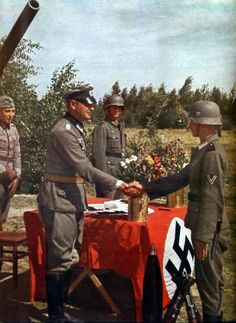 German Army officer shake hands with his soldier in the latter's proxy marriage wedding ceremony. Picture allegedly taken in the outskirts of Stalingrad, summer 1942