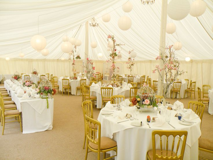 Stunning table centrepieces in the marquee at Prested Hall http://www.prested.co.uk/weddings/
