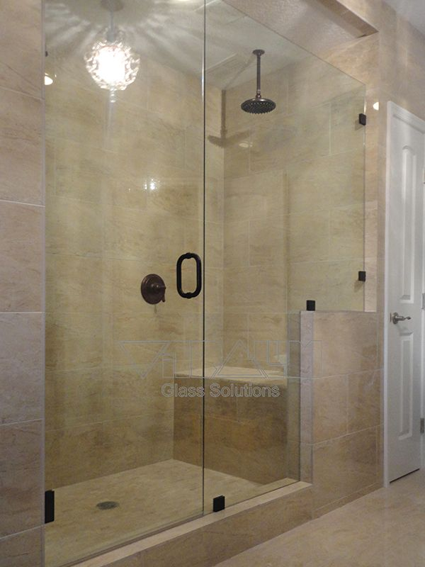 Frameless shower enclosures orlando bathroom shower doors for Florida bathroom ideas