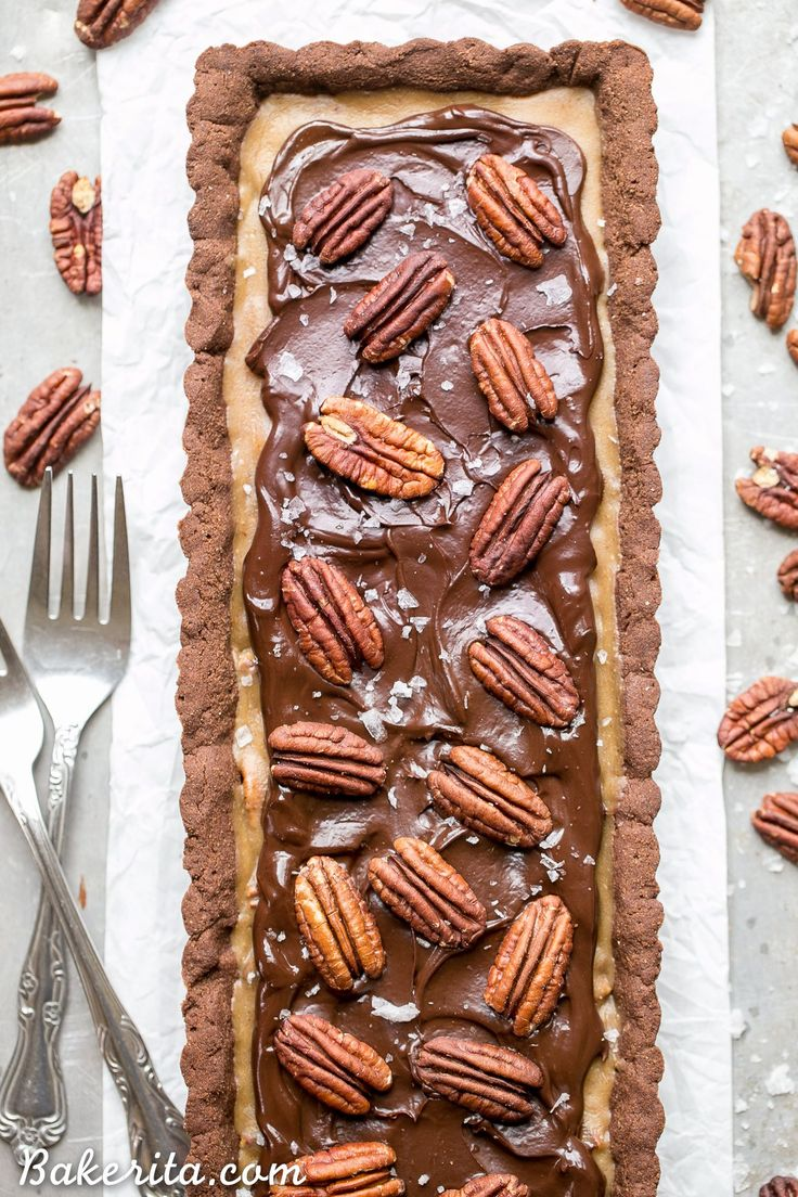 This Chocolate Pecan Tart has a chocolate shortbread crust, pecan pie filling, and is topped with dark chocolate ganache, pecans + a sprinkle of sea salt! You won't believe that this is gluten-free, Paleo, refined sugar free, and vegan.
