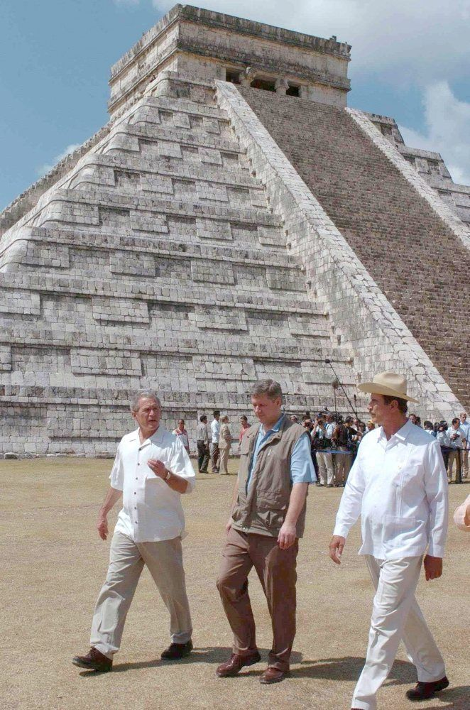 Harper chose to wear what amounts to a fishing vest on a trip to Mexico in 2006 (where he visited with U.S. President George Bush (left) and Mexican President Vincente Fox (right)).