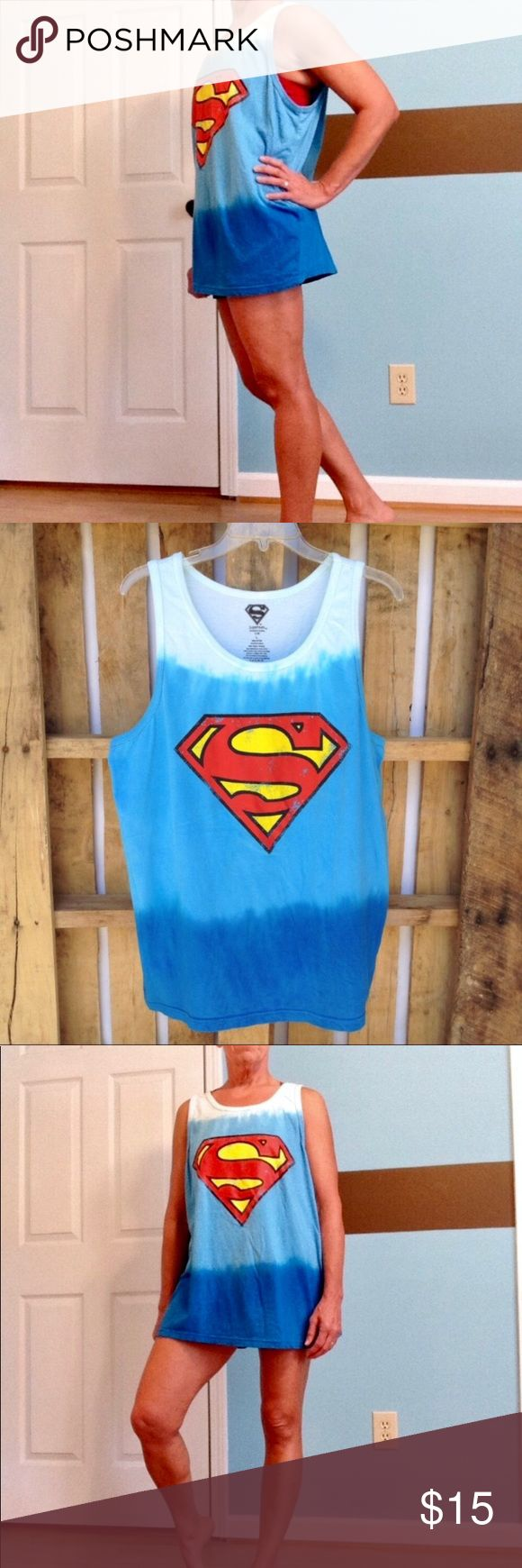 "Ombré distressed Superman graphic tank top This loose fitting Superman tank top could be worn alone, or as a swimsuit coverup. 100% cotton. Distressed Superman emblem.  There is one spot on the back right shoulder otherwise absolutely perfect!  APPROX FLAT MEASUREMENTS  26"" ↕️ 24"" ↔️ pit to pit BG22 #superman #blueombre #tanktop DC Comics Tops Tank Tops"