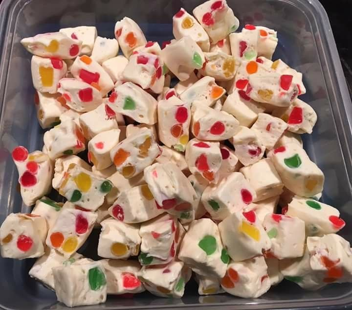Nougat: 2 tbsp Butter 2 bags Mini Marshmallows (250g per bag) 2 bags White Chocolate Chips (225g per bag) 2 cups Gumdrops  Melt first 3 ingredients together until smooth. Mix in gumdrops.  Spread on parchment paper lined 9x13 pan.  Chill overnight in fridge.  Cut into squares.   **can be stored in freezer