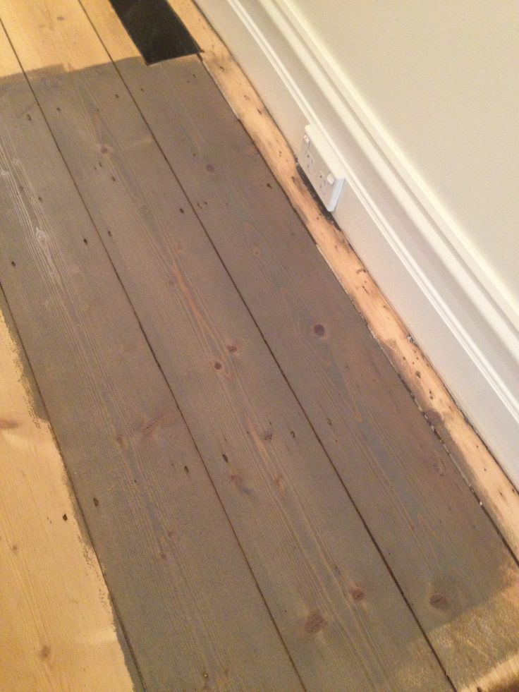 Osmo Polyx Oil Tints (3074 Graphite) on old Baltic Pine floor.