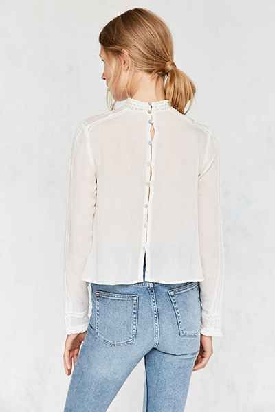 I love the low mock neck and the buttons down the back! Although it would be nice if the button stand wasn't see-through...