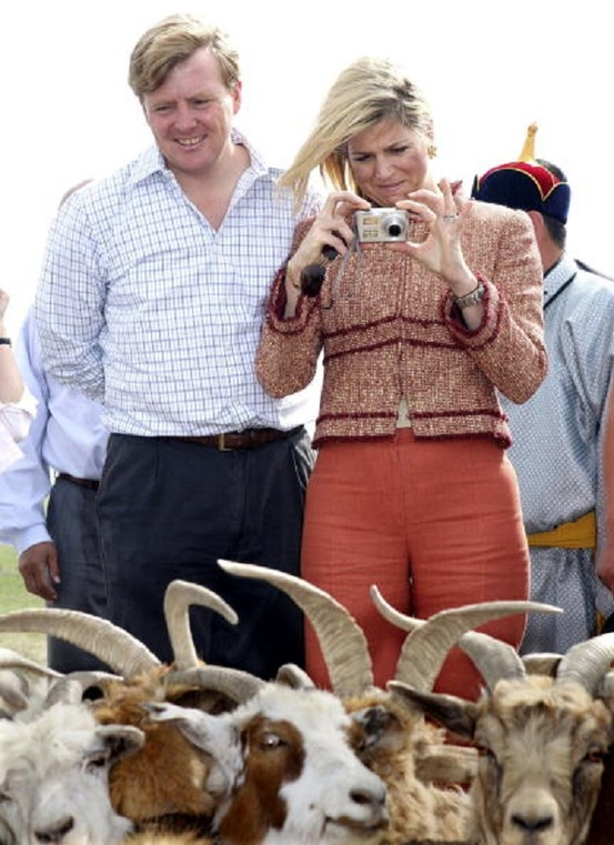 Dutch Crown Prince Willem Alexander and Crown Princess Maxima take pictures at the Ger Community in Hustai National Park buffer zone on 17 June 2006 in Ulan Bator, Mongolia