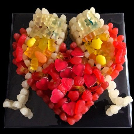 For those special occasions when celebrations are necessary, the Champagne Heart says it all! Packed with a large variety of jellies, foam, sours, etc. Made for sharing it sums up the essence of the event - Cheers!
