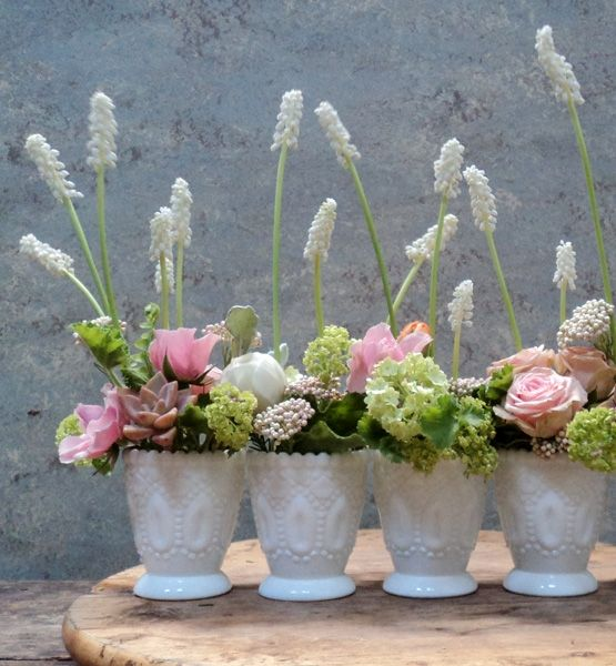 Multiple Choice  A bunch of identical containers such as tumblers, votive holders or these sweet, mini antique vases make a big impact. For this trend, the magic is in the details: The repeated pattern makes for a modern centerpiece on any table or mantle.
