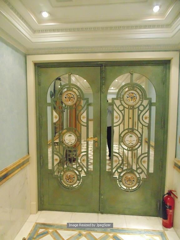 Lot 1252 - A pair of Iron doors each 800mm x 2000mm x 60mm with a central mirror panel and bespoke cast window