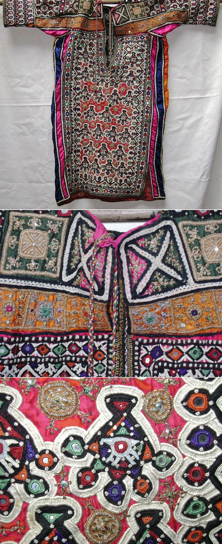 The front of a woman's chola blouse, heavily embroidered with mirror or shisha work. Lohana Sindh, Pakistan.  Mid-20th century.  With close-ups of the embroideries.  (Kavak Costume Collection - Antwerpen/Belgium).