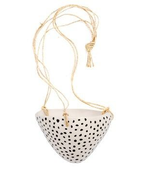 This small speckled hanging pot would make an ideal home for air plants in a bedroom or herbs in the kitchen.
