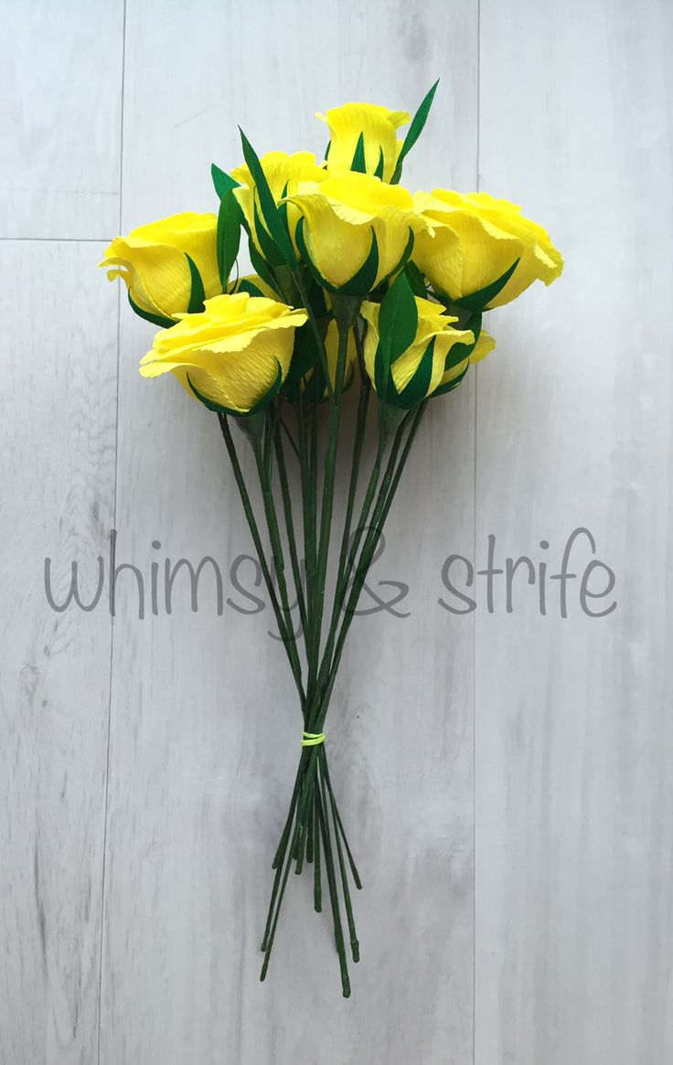 12 roses in yellow all with leaves. Made with crepe paper and fully wired.