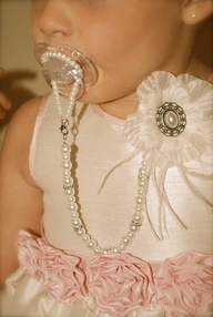 for the glam baby... diy long pearl necklace safety pinned to dress and looped through pacifier to keep it from falling or getting lost. ravishing, dahling!