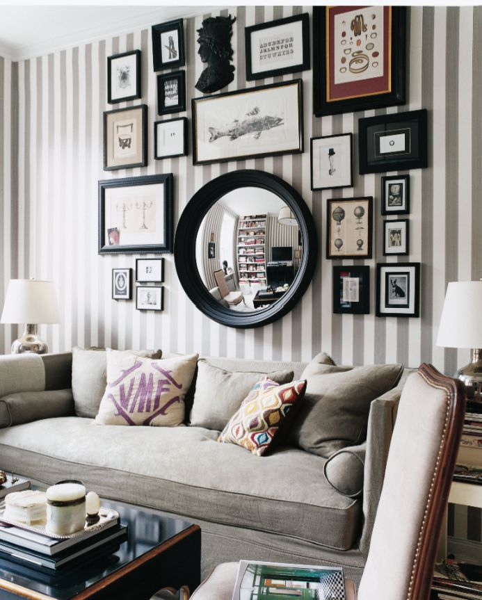 Decorating With Stripes For A Stylish Room: A Gallery Wall Hung Over A Striped Wallpaper Makes A Bold