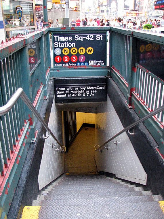 Times Square Subway- I stood in a pouring thunderstorm once before running into this quickly flooding train entrance in Times Square. Water off the streets was pouring down the side of the entrance like a waterfall. Once inside, I had to teach two NYC policemen how to purchase and use metro cards.