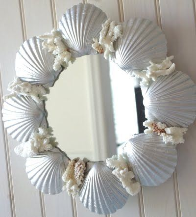 Simple Round Shell Mirror made with shells found on the beach. But if you don't have access to shells and/or don't want to make a mirror, consider buying from Etsy artists. Carol of Beautiful Details has this lovely round mirror in her store. And you can find more handmade mirrors at Beach Grass Cottage and Seashell Collection!