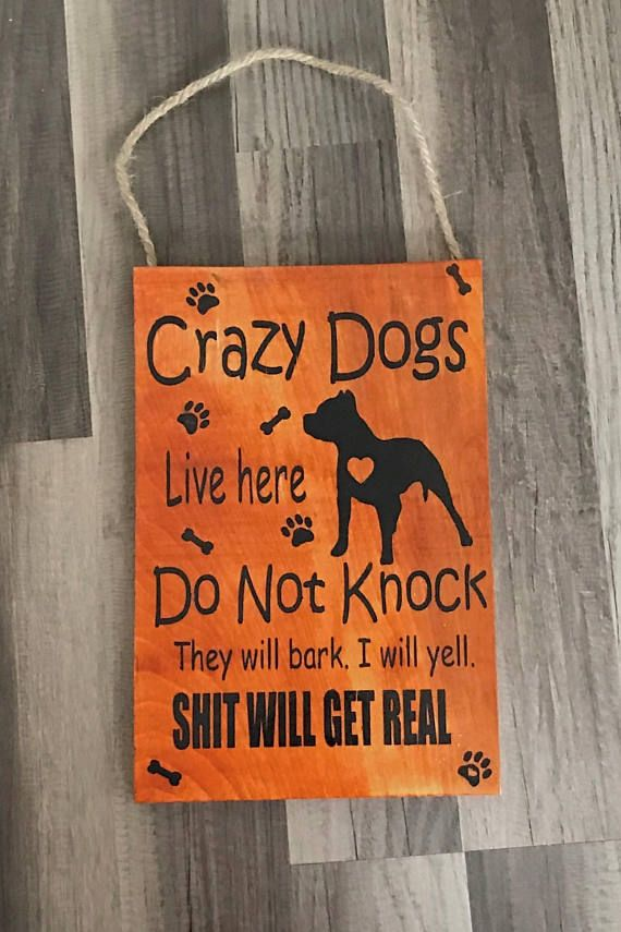 Wooden Door Hanger for homes with crazy dogs when they hear a knock or door bell. Sign is stained and painted then it has a clear coat so that it can withstand the weather. The sign can be personalized and the color can be changed for the paint. Ordering Instructions: Please if
