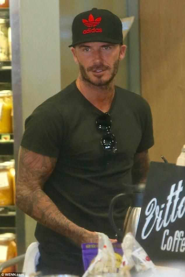 David Beckham wearing Victoria Beckham the Vb Sunglasses in Black Acetate, Adidas Nmd R1 in White and Adidas Originals Trefoil Chain Snapback in Black/Red