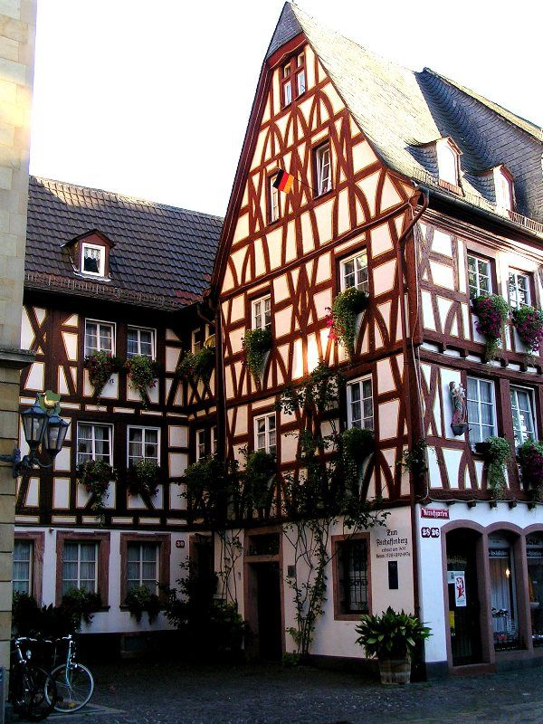 Fachwerk houses in Mainz.  When people think of Germany, many people will think of these timber-framed buildings. Germany has noted several cities that have these type of buildings and calls it the Fachwerk Strasse.