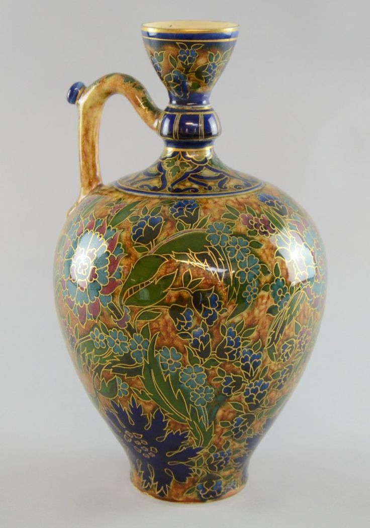 Lot: Zsolnay Pecs Persian style Ewer, formal decoration of, Lot Number: 0004, Starting Bid: £100, Auctioneer: Ewbank's, Auction: 20th Century Art & Design, Date: October 22nd, 2014 CEST