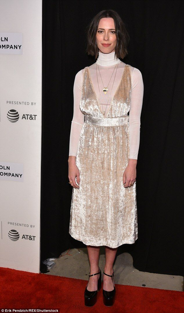 Quirky look: Rebecca Hall, 34, opted for an off-white velvet smock over a thin white turtleneck. She wore chunky black shoes and accessorized with a couple of gold pendant chains