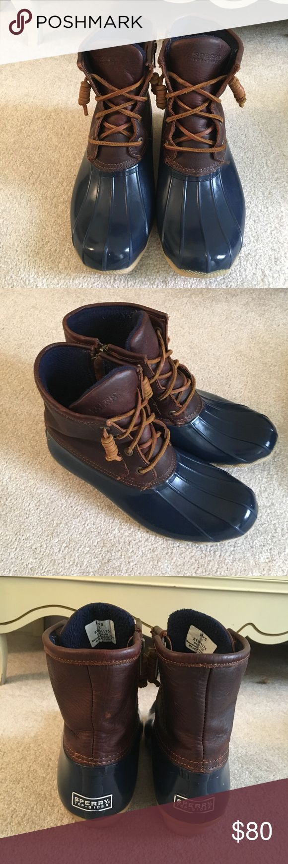 Sperry Duck Boots EUC Sperry Topsider duck boots. used for two New York winters and have held up wonderfully! They have just been cleaned and the rubber has been shined so they are practically brand new! size 8 but could fit a 7.5 too. Brown leather with navy rubber and leather laces Sperry Top-Sider Shoes Winter & Rain Boots