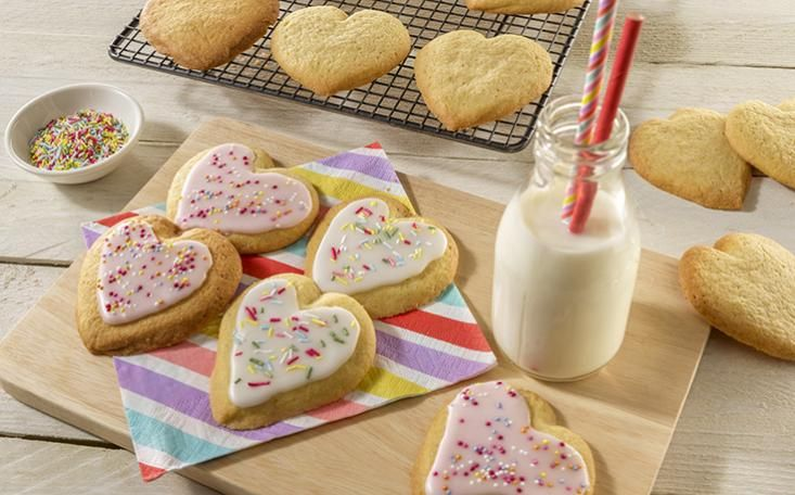 You can't go wrong with this simple sugar cookie recipe, it makes chewy and delicious cookies every time. #bakewithstork #storkrecipes #stork #sugarcookies #cookies #cookierecipe #icing #sprinkles #kidsbake #biscuits #biscuitrecipe #heartbiscuits #hearts