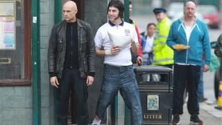 Mark Strong and Sacha Baron Cohen in Grimsby