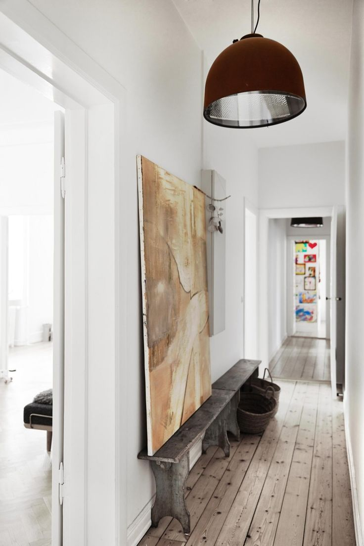 White hallway with wooden benches and a large painting | Styling Irene de Klerk Wolters | Photographer Birgitta Wolfgang Drejer / Sisters Agency | vtwonen June 2015